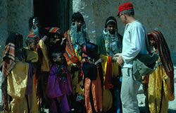 Grivetti with children at Qara Oasis,Western Desert of Egypt, Spring, 1966